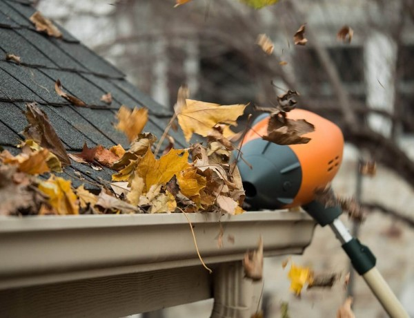 Blowing Leaves out of Gutter Pipe